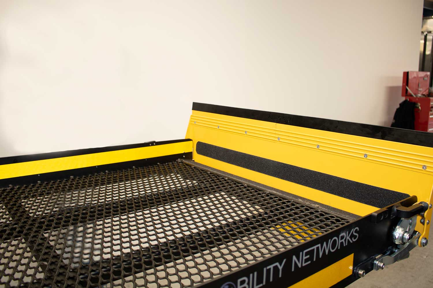 Weatherproof mesh platform and non-slip material on roll off ramp
